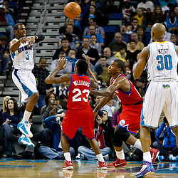 January 3, 2011; New Orleans, LA, USA; New Orleans Hornets point guard Chris Paul (3) passes to power forward David West (30) during the first quarter against the Philadelphia 76ers at the New Orleans Arena.   Mandatory Credit: Derick E. Hingle