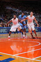 Ohio State forward Dallas Lauderdale #52 and Jon Diebler #33 block out North Carolina forward Ed Davis #32 during the 2K Sports Classic at Madison Square Garden.