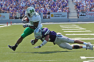Marshall running back Chubb Small (28) bounces off a hit from Kansas State's Kyle Williams (9) during a first down run, at Bill Snyder Family Stadium in Manhattan, Kansas, September 16, 2006.  The Wildcats beat the Thundering Herd 23-7.