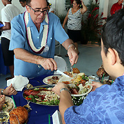 Chairman of Tri Marine, Renato Curto, humbly serves other VIP's before eating at the luncheon following the STP/TriMarine Cannery Innauguration ceremonies and festivities, Satala, Tutuila, American Samoa. 1/24/15,  Photo by Barry Markowitz.