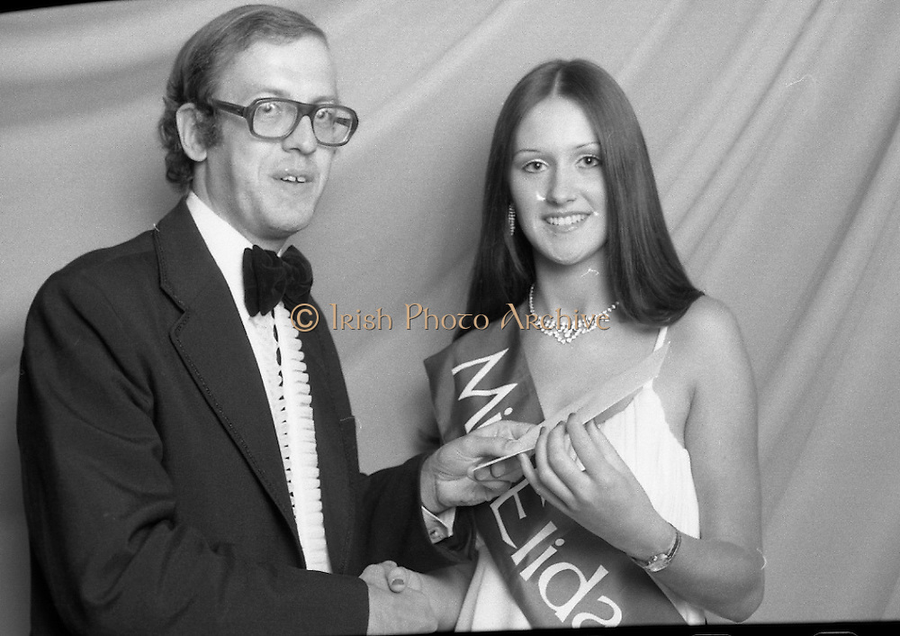 """Miss Elida"" Final At Mosney, Co Meath..1976..01.09.1976..09.01.1976..1st September 1976..The final of the ""Miss Elida"" lovely hair competition was held in The Gaiety Theatre,Butlins Holiday Centre,Mosney,Co Meath tonight. The competition is sponsored by Lever Bros,Sheriff St,Dublin. The shows compere was Mr Mike Murphy..Pictured receiving her winners award is Ms Frances Campbell,Culmore, Co Derry."