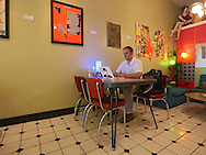 Hunter Capoccioni of Waterloo works on his computer at Cup of Joe in Cedar Falls, Iowa on Tuesday, July 10, 2012. Capoccioni is a professor at the University of Northern Iowa.