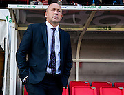 Accrington Stanley manager John Coleman watches from the dugout during the Sky Bet League 2 match between Crawley Town and Accrington Stanley at the Checkatrade.com Stadium, Crawley, England on 26 September 2015. Photo by Bennett Dean.