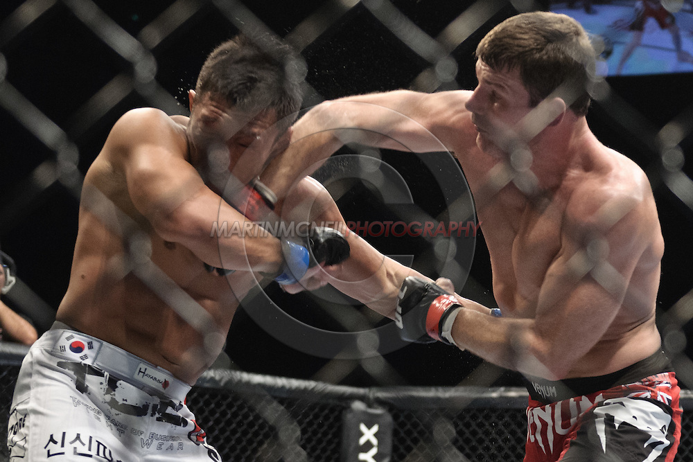 "LONDON, ENGLAND, OCTOBER 2010:  Yoshihiro Akiyama (left) is stunned by an overhand right from Michael Bisping during ""UFC 120: Bisping vs. Akiyama"" inside the O2 Arena in Greenwich, London"