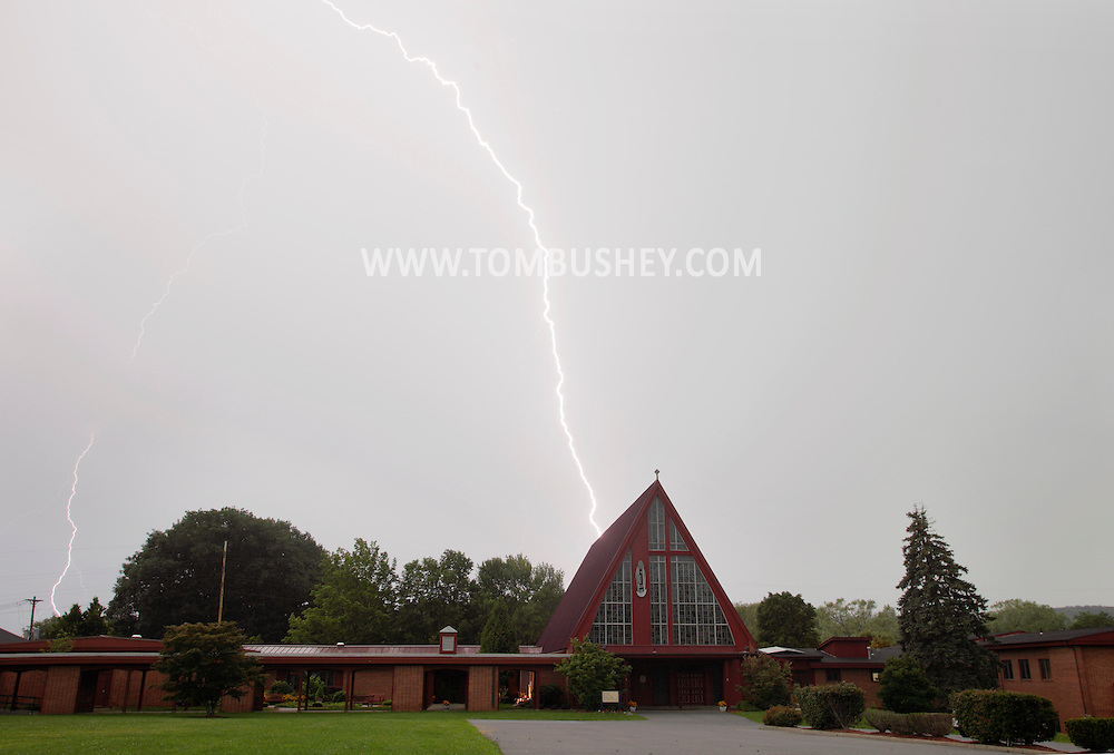 Middletown, NY - Lightning strikes behind the main chapel at the National Shrine of Our Lady of Mount Carmel during a summer thunderstorm on Aug. 10, 2009.