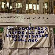 Writing on the wall of Tent City University tent, a tent used for workshops and meetings through-out the occupation. The writing says; 'World debt = $1.5 quadrillion unsustainable dollars. End derivatives.' The camp Occupy London Stock Exchange outside St Paul's Cathedral was in the morning served with eviction notice after months of legal battle with the Corporation of London. The site was occupied Oct 15th.