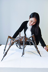 """© Licensed to London News Pictures. 17/02/2017. London, UK.   A staff member views """"Spider"""" by Louise Bourgeois, at a preview of """"Traumata: Bourgeois/Kusama"""".  The joint exhibition is dedicated to the work of Louise Bourgeois and Yayoi Kusama, and takes place at Sotheby's S/2 Gallery 23 February to 13 April. Photo credit : Stephen Chung/LNP"""