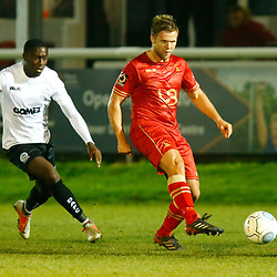 Hartlepool's defender Carl Magnay passes the ball with Dover's midfielder Nortei Nortey on his back during the National League match between Dover Athletic FC and Hartlepool United FC at Crabble Stadium, Kent on 24 November 2018. Photo by Matt Bristow.