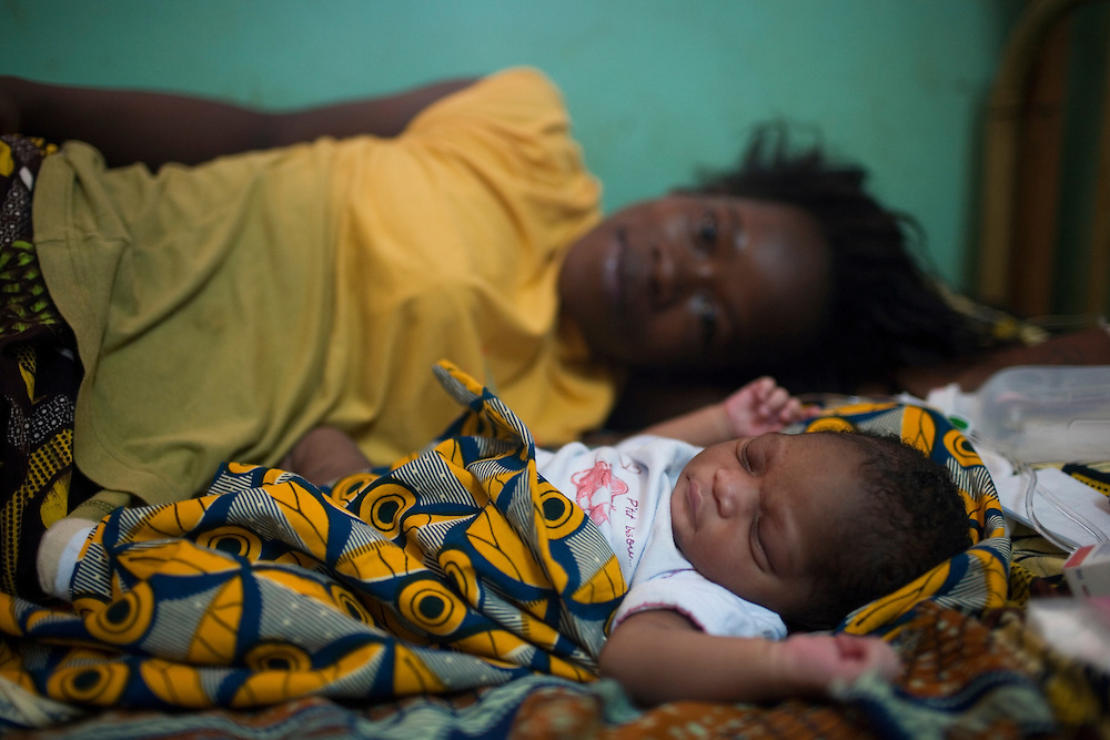 Rasmata, 25 with her newborn baby that she delivered yesterday without problems, although she felt the doctors were a bit brutal with her and lying for hours in the coorrdior and on the floor in the maternity room, she feels happy with the service she recievd.   Model released. Hospital Yalgado, Ouagadougou, Burkina Faso
