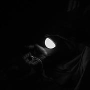An old sage prepares a good luck amulet to a young man who is about to embark on the journey from Guinea-Bissau to Europe<br /> <br /> Un viejo sabio prepara un amuleto de buena suerte a un joven que est&aacute; a punto de emprender el viaje de Guinea Bissau a Europa