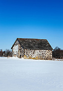 Old farm shed in winter snow, Moorestown, New Jersey, USA.