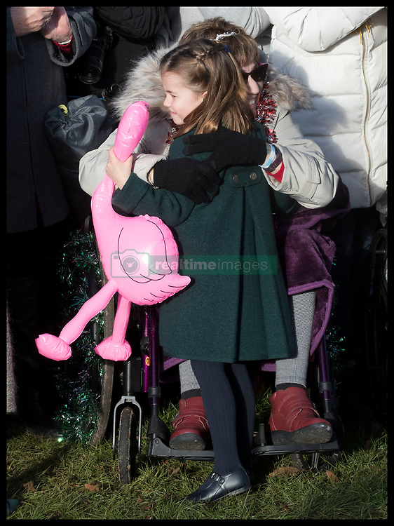 December 25, 2019, Sandringham, United Kingdom: Image licensed to i-Images Picture Agency. 25/12/2019. Sandringham, United Kingdom. Princess Charlotte is hugged by a well wisher as she leaves the Christmas Day church service at Sandringham in Norfolk, United Kingdom. (Credit Image: © Stephen Lock/i-Images via ZUMA Press)