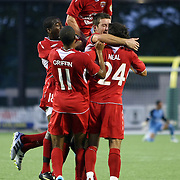 Orlando City Lions Forward Jamie Watson (77)jumps on the celebration of the first goal during the United Soccer League Pro American Division Championship soccer match between the Richmond Kickers and the Orlando City Lions at the Florida Citrus Bowl on August 27, 2011 in Orlando, Florida. Orlando won the match 3-0 to advance to the USL Pro Final.  (AP Photo/Alex Menendez)