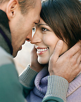 Couple looking in each others eyes outdoors close up