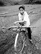 Young girl on bike in farm fields