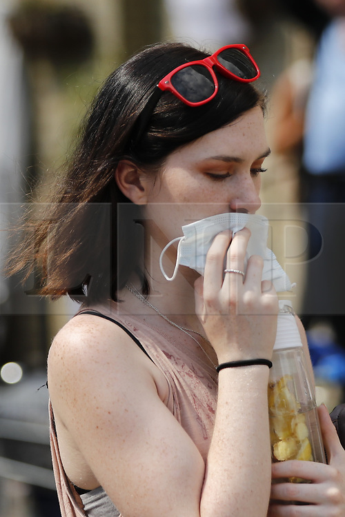 © Licensed to London News Pictures. 14/06/2017. London, UK. Residents use face masks as the Grenfell Tower fire is still not under control 14 hours after the fire broke in west London on 14 June 2017. Photo credit: Tolga Akmen/LNP