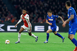 Ryan Gravenberch #29 of Ajax and Mauro Arambarri #18 of Getafe in action during the Europa League match R32 second leg between Ajax and Getafe at Johan Cruyff Arena on February 27, 2020 in Amsterdam, Netherlands