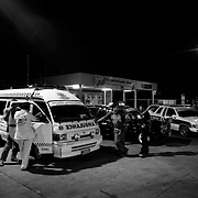 A typical night for Ruamkatanyu volunteers involves many hours of waiting on gas station forecourts or in quiet side roads monitoring the police frequencies on their radios, smoking, drinking energy drinks and waiting for an accident to happen...Ruamkatanyu is a private Thai charity funded by donations. It's members are volunteers who using their own customised vehicles to respond to road accidents, suicides, fires, bar fights and anything else involving death or injury. With varying degrees of medical training they try to stabalize the injured before transporting them to hospital or in the case of deaths take the bodies to the morgue. These volunteer ambulance crews have been nicknamed 'The Body Snatchers'.