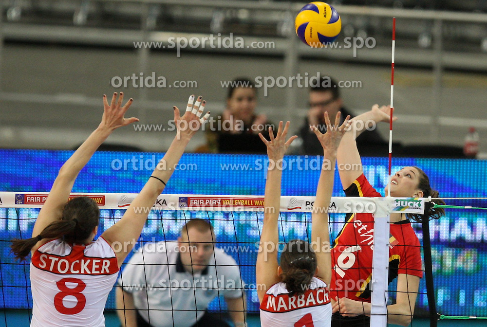 04.01.2014, Atlas Arena, Lotz, POL, FIVB, Damen WM Qualifikation, Belgien vs Schweiz, im Bild Charlotte LEYS (BEL), Sandra STOCKER (SUI), Kristel MARBACH (SUI) // Charlotte LEYS (BEL), Sandra STOCKER (SUI), Kristel MARBACH (SUI) during the ladies FIVB World Championship qualifying match between Belgium and Switzerland at the Atlas Arena in Lotz, Poland on 2014/01/05. EXPA Pictures &copy; 2014, PhotoCredit: EXPA/ Newspix/ Tomasz Jastrzebowski<br /> <br /> *****ATTENTION - for AUT, SLO, CRO, SRB, BIH, MAZ, TUR, SUI, SWE only*****