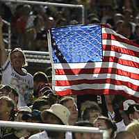 UCF football fans cheer in remembrance of 9/11, during an NCAA football game between the Boston College Eagles and the UCF Knights at Bright House Networks Stadium on Saturday, September 10, 2011 in Orlando, Florida. (AP Photo/Alex Menendez)