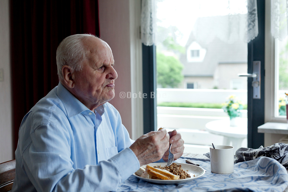 senior man eating alone