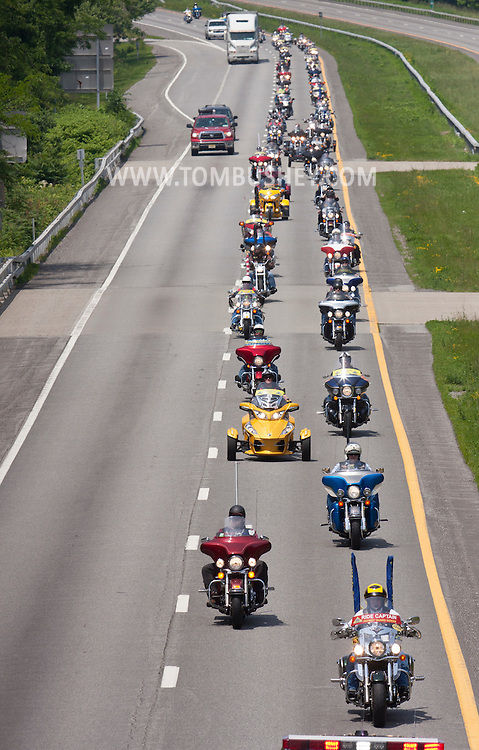 Monroe, New York - Patriot Guard Riders lead the procession carrying Army Capt. Jason B. Jones on Route 17 on the way to funeral services at West Point on June 17, 2014.  Jones was killed in Afghanistan on June 2, 2014.
