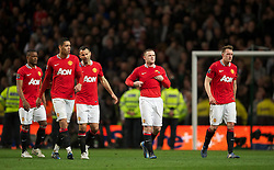MANCHESTER, ENGLAND - Monday, April 30, 2012: Manchester United's players Patrice Evra, Chris Smalling, Ryan Giggs, Wayne Rooney and Phil Jones look dejected after losing the Premiership match against Manchester City 1-0 at the City of Manchester Stadium. (Pic by David Rawcliffe/Propaganda)