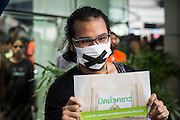 "01 JUNE 2014 - BANGKOK, THAILAND: A man protests the loss of free speech against the Thai coup at Terminal 21, a popular shopping mall in Bangkok. The Thai army seized power in a coup that unseated a democratically elected government on May 22. Since then there have been sporadic protests against the coup. The protests Sunday were the largest in several days and seemed to be spontaneous ""flash mobs"" that appeared at shopping centers in Bangkok and then broke up when soldiers arrived. Protest against the coup is illegal and the junta has threatened to arrest anyone who protests the coup. There was a massive security operation in Bangkok Sunday that shut down several shopping areas to prevent the protests but protestors went to malls that had no military presence.    PHOTO BY JACK KURTZ"
