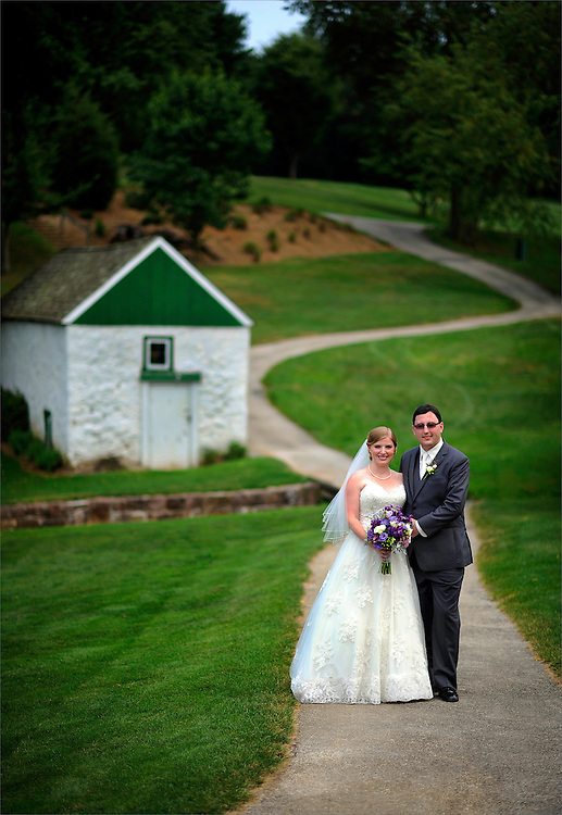 A bride and groom at their wedding held at Phoenixville Country Club in Phoenixville, Pennsylvania.