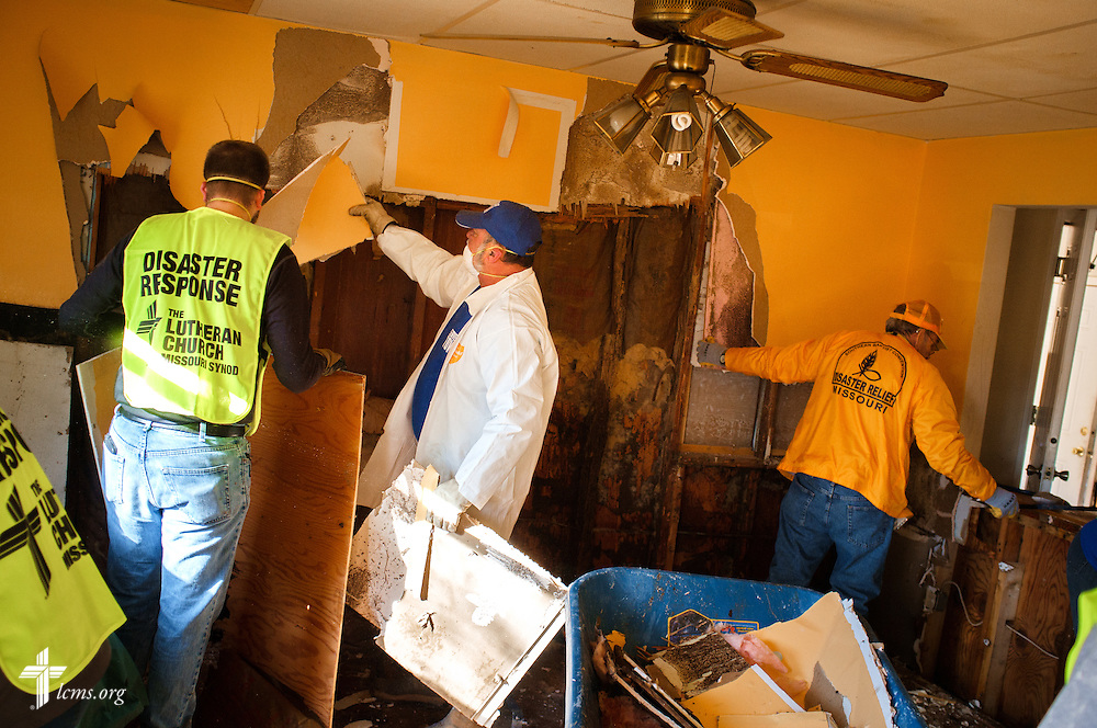 Volunteers from the International Center of The Lutheran Church–Missouri Synod, New Beginnings Lutheran Church in Pacific, Mo., and Missouri representatives of the Southern Baptist Convention Disaster Relief, work together at a flooded home in Fenton on Thursday, Jan. 14, 2016. LCMS Communications/Erik M. Lunsford