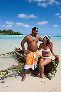 Cook islands, New Zealand, Local couple in a dugout canoe
