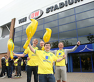 The traveling Norwich fans young and old create a great atmosphere before the Barclays Premier League match at the DW Stadium, Wigan...Picture by Paul Chesterton/Focus Images Ltd. .07904 640267.13/8/11
