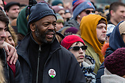 """Brooklyn, NY - 2 March 2019. A man wears a pin that reads """"I am an illegal immigrant"""" at Bernie Sanders' first rally for the 2020 presidential primary at Brooklyn College."""