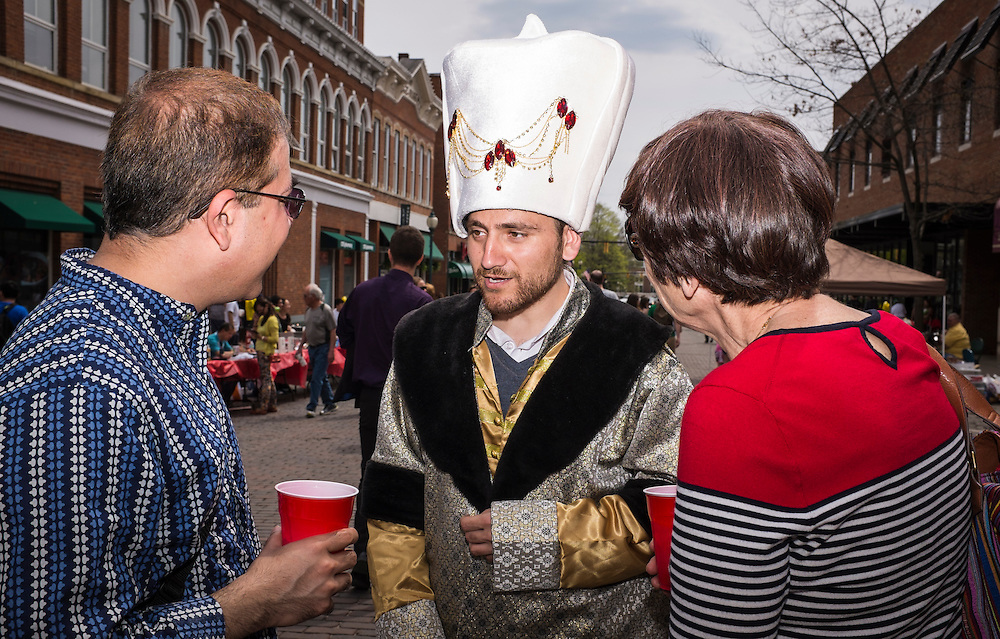 Muhammet Jolih Ariturk, a member of the Turkish Students Association, chats with visitors during the International Street Fair on Saturday, April 18, 2015.  Photo by Ohio University  /  Rob Hardin