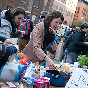 Breakfast in a make-shift kitchen. Day three of the occupation - and the first Monday.  The Occupy London Stock Exchange movement was formed in London in solidarity with the US based Occupy Wall Street. The movements are a respons and in anger to what is seen by many as corporate greed and a failed banking system being bailed out by the public, - which in return are suffering austerity measures to make up for the billions of lost money. The movement occupied the St Paul's Square in the City of London Sat Oct 15 after it failed to secure and occupy Pator Noster Square and the Stock Exchnage itself.
