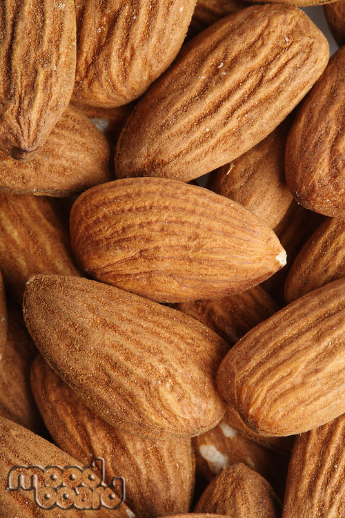 Almonds on white background - close-up