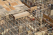 the various stages of building a large building site under construction