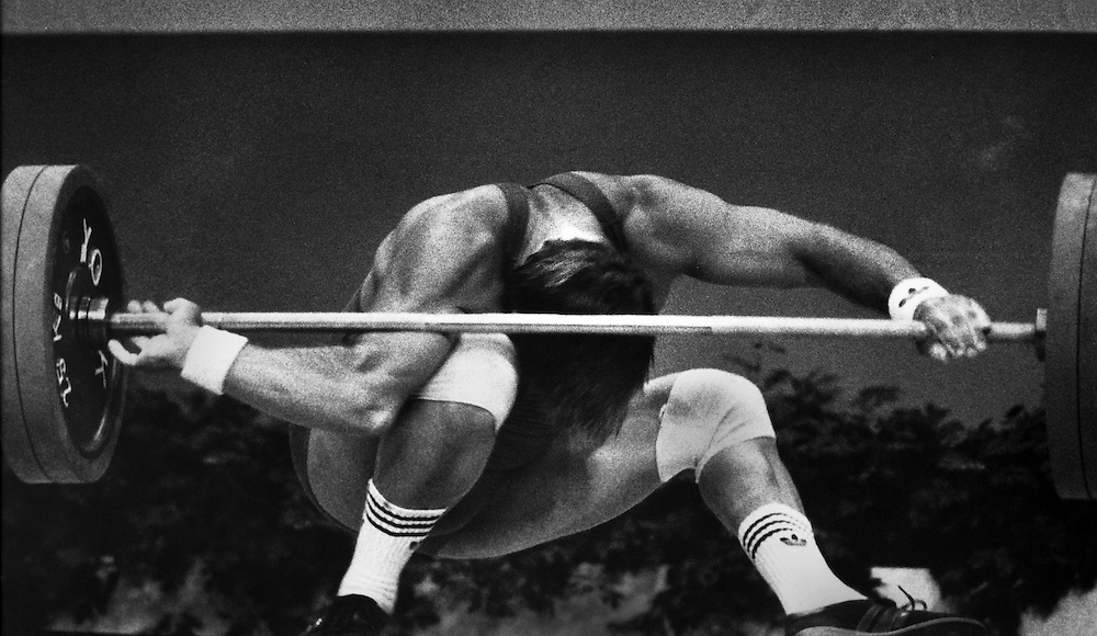 Weightlifter Derrick Crass of the USA loses control during the 198-pound class during the Olympic Summer Games in Los Angeles, CA.  (1984)
