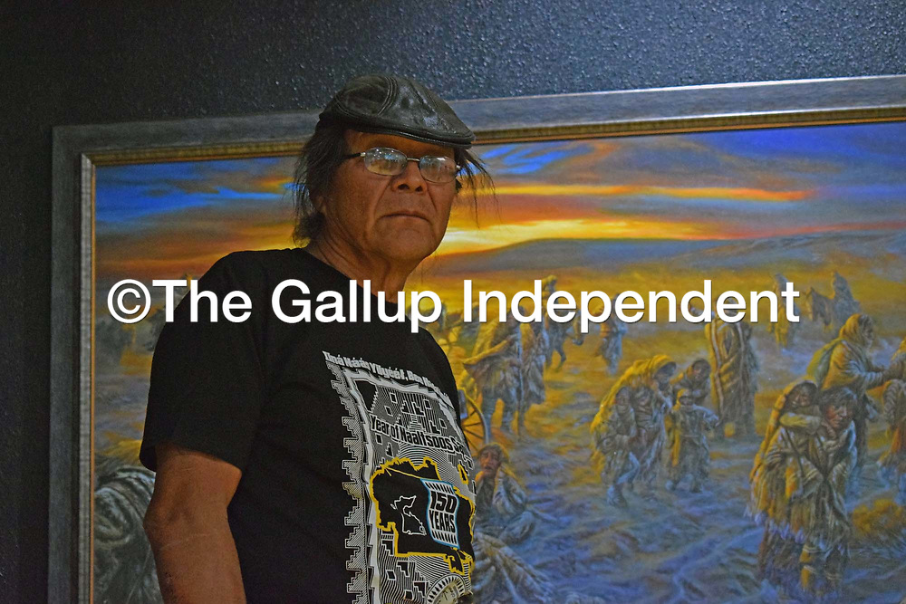 "Shiprock artist James King poses in front of his ""Long Walk"" painting Friday at the navajo Nation Museum in Window Rock, Arizona."