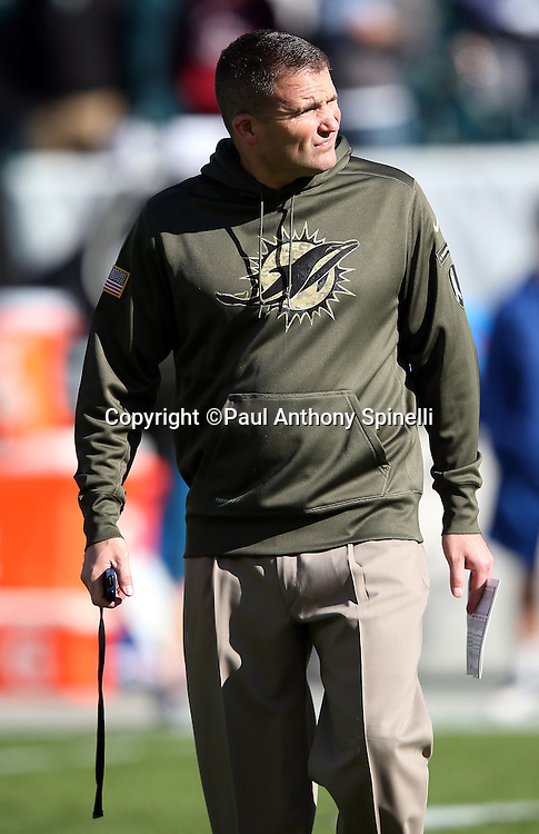 Miami Dolphins assistant head coach / special teams coordinator Darren Rizzi watches pregame warmups before the 2015 week 10 regular season NFL football game against the Philadelphia Eagles on Sunday, Nov. 15, 2015 in Philadelphia. The Dolphins won the game 20-19. (©Paul Anthony Spinelli)