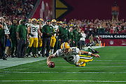 Aaron Rogers dives for a first down late in the 2nd quarter.<br /> <br /> NFL Divisional Playoffs: Green Bay Packers vs Arizona Cardinals<br /> NFL Divisional Playoffs: Green Bay Packers vs Arizona Cardinals<br /> University of Phoenix Stadium/Glendale, AZ <br /> 01/16/2016<br /> SI-181 TK1<br /> Credit: John W. McDonough