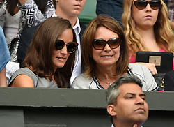 Image licensed to i-Images Picture Agency. 06/07/2014. London, United Kingdom. Pippa Middleton with her parents Michael and Carole Middleton watch the Wimbledon Men's Fina.  Picture by i-Images