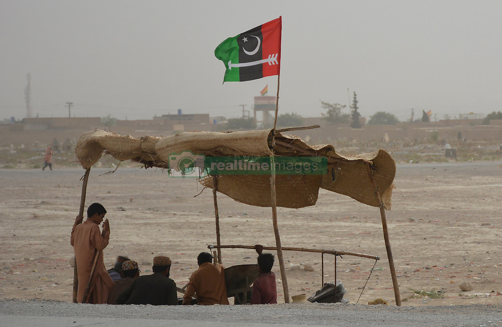 July 4, 2018 - Quetta, Balochistan, Pakistan - Workers of political party campaign for general election 2018, In Quetta, Imran Khan's campaign team for 25 July, 2018 will have to plausibly link the slogan of anti-corruption with Pakistan's impoverished economic conditions. In Balochistan more than 303 candidates contest for National Assembly seats and for Provincial Assembly 1,007 candidates contesting seats in Quetta the Provincial Capital of Balochistan province. (Credit Image: © Muhammad Arshad/Pacific Press via ZUMA Wire)