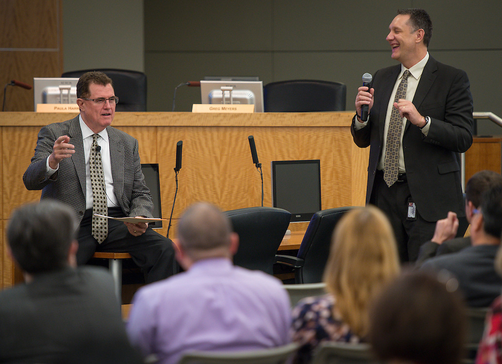 Houston ISD superintendent Dr. Terry Grier, left, and Chief Technology Officer Lenny Schad, right, update staff on Windows 7 upgrades during a Central Office staff meeting, April 8, 2014.