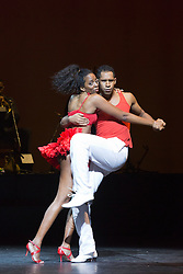 "© Licensed to London News Pictures. 07/07/2014. London, England. Yolanda Reis and James Batista dancing. Claudio Segovia's show ""Brasil Brasileiro"" opens at Sadler's Wells Theatre with 35 performers from Rio de Janeiro. Conceived and directed by Claudio Segovia, this Brazilian music and dance show runs from 8-27 July 2014.  Photo credit: Bettina Strenske/LNP"