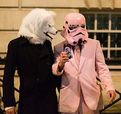 London, November 05 2017. Anti-capitalists gather in Trafalgar Square, London for the annual 'Million Mask March' which happens on November 5th every year, with many of the protesters donning 'V' For Vendetta Guy Fawkes masks. Past marches have turned violent with police horses shot by fireworks and police vehicles burned. PICTURED: A Stormtrooper and a wolf take a selfie on Whitehall. © Paul Davey