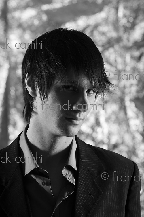 Studio shot of an handsome and expressive man on isolated silver background