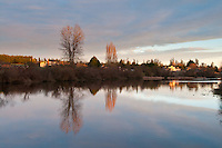 Blenkinsop Lake is a mirror reflection of the sky above on a winter's evening in Victoria, BC