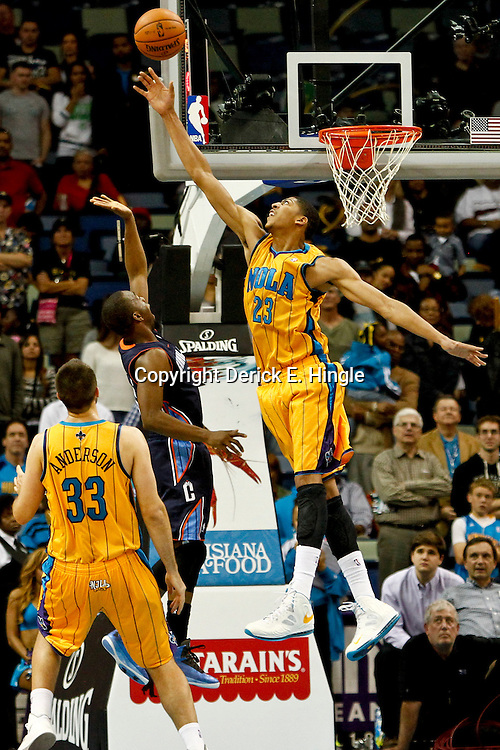 November 9, 2012; New Orleans, LA, USA; Charlotte Bobcats power forward Bismack Biyombo (0) shoots over New Orleans Hornets power forward Anthony Davis (23) during the second half of a game at the New Orleans Arena. The Hornets defeated the Bobcats 107-99. Mandatory Credit: Derick E. Hingle-US PRESSWIRE