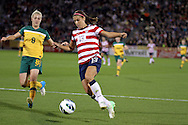 September 19, 2012 Commerce City, CO.  Australia d Danielle Brogan (8) watches as USA f Alex Morgan (13) gathers up a pass during the Soccer Match between the USA Women's National Team and the Women's Australian team at Dick's Sporting Goods Park in Commerce City, Colorado